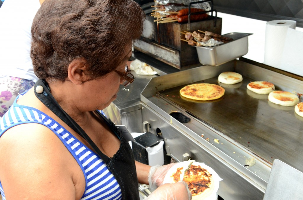 Maria Cano, the Arepa Lady, prepares Colombian arepas at the festival. (Ruohan Xu)