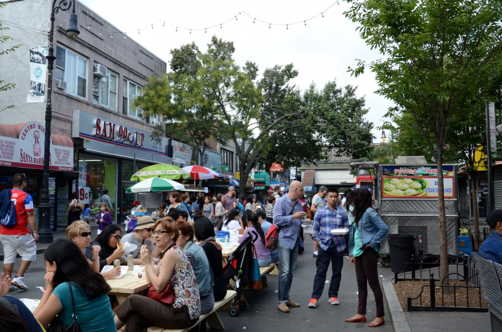 82nd street is crowed by visitors in the afternoon during the Viva La Comida festival. (Ruohan Xu)