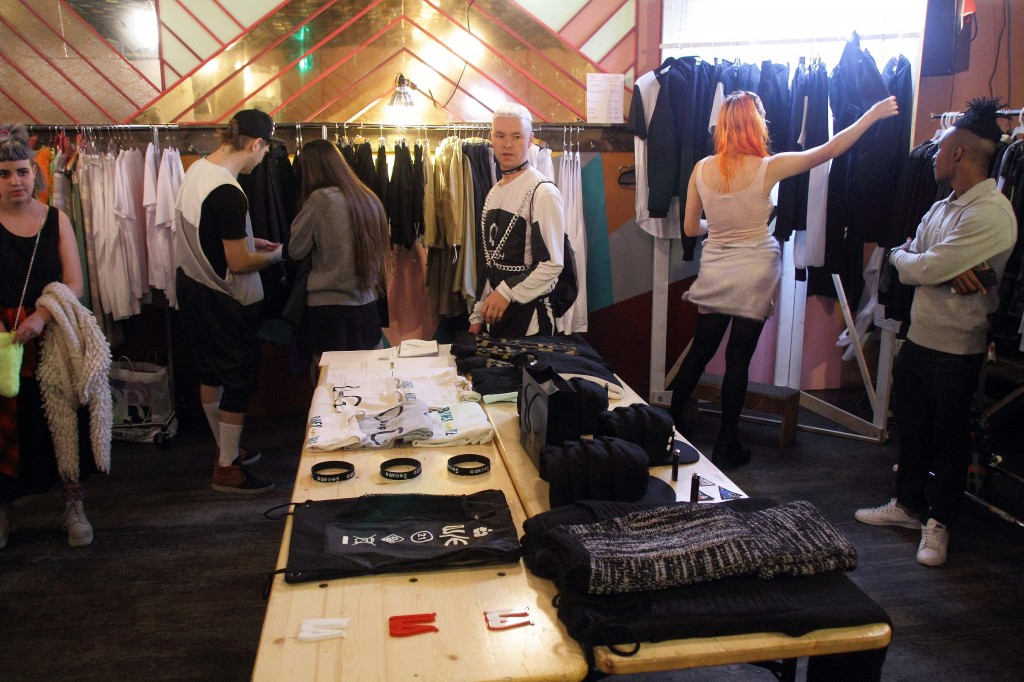 The scene at the back of the Tandem Bar showed multiple clothing and accessories for sale by local designers.  Photo by Alberto Zamora 20th of September 2014.
